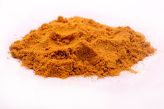Pile of curry powder. Image of a pile of curry powder isolated on white Stock Photo