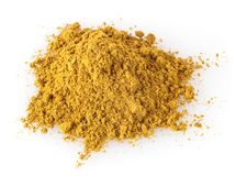 Pile of curry powder isolated on white royalty free stock photo