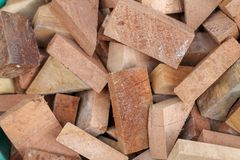 Pile of cut logs as a natural look background. Multi wood shape and size royalty free stock photography