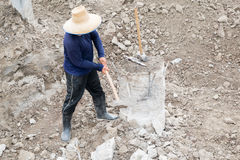 Pile cut-off. A construction worker cuts a concrete bored pile at pile's cut off level Royalty Free Stock Photos