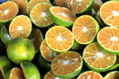 A pile of cut-open oranges Royalty Free Stock Images