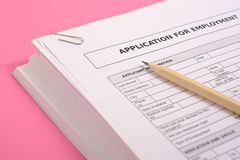 Pile of cv on pink background as equal opportunities concept stock photos