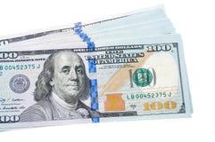 Pile d'argent les dollars de fond nous ont isolés blancs Images libres de droits