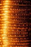 Pile d'or de pièces de monnaie du dollar Photo stock