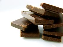 Pile of Dark Chocolate. Image of pieces of dark chocolate piled together, to the right of the image.  Space remains to the left for text or other material Stock Photography