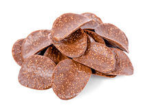 Pile of dark chocolate chips is isolated on white background, cl Royalty Free Stock Photography