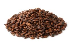 Pile  of dark malted barley seeds. Isolated on white royalty free stock photo