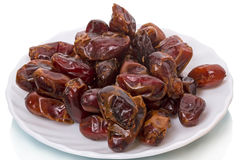Pile of dates on a plate Royalty Free Stock Photos