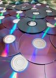 Pile de beaucoup de Cd ou de DVDs Image stock