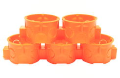 Pile de boîtes électriques oranges sur le fond blanc Images stock