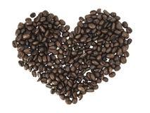 Pile de café rôti avec des formes de coeur Photographie stock libre de droits