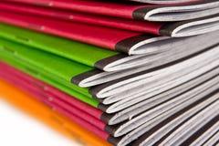 Pile de cahiers de couleur Photographie stock libre de droits