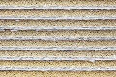 Pile de carton avec le caoutchouc mousse Photos stock