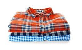 Pile de chemises colorées Images stock