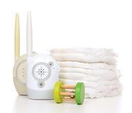 Pile de dispositif de moniteur de radio d'enfant de bébé d'enfant des couches-culottes et du bébé à Photo stock