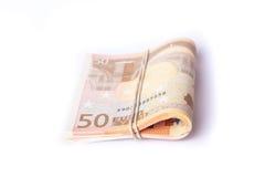 pile de 50 euro billets de banque enveloppée et roulée Photo stock