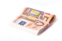pile de 50 euro billets de banque enveloppée et roulée Image libre de droits