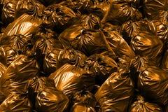 Pile de fond d'orange de sacs de déchets, poubelle, déchets, déchets, déchets, pile de sachets en plastique images stock