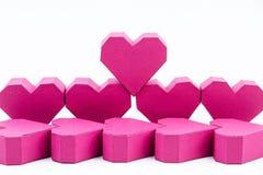 Pile de forme rouge de coeur de boîte de papier sur le fond rose avec la copie Images libres de droits