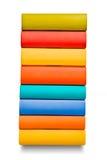 Pile de livres colorés d'isolement sur le blanc Photos libres de droits