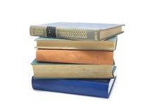Pile de livres colorés multi d'isolement sur le blanc photographie stock libre de droits