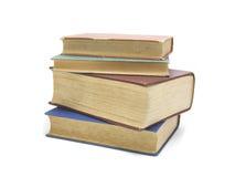 Pile de livres colorés multi d'isolement sur le blanc image stock