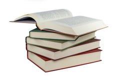Pile de livres d'isolement sur le blanc image stock