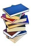 Pile de livres d'isolement sur le fond blanc Image libre de droits