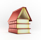 Pile de livres formant une maison Photo stock