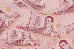 Pile de nouveaux 100 billets de banque de baht thaïlandais photos stock