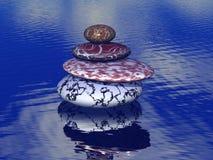 Pile de pierres équilibrées sur la mer Photos libres de droits
