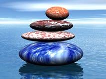 Pile de pierres équilibrées sur la mer Image libre de droits