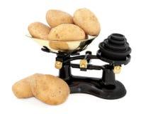 Pommes de terre de cuisson Photographie stock