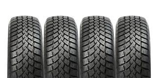 Pile de quatre pneus de l'hiver de roue de véhicule d'isolement Photos libres de droits