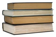 Pile de quatre vieux livres Photos stock