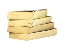 Pile de quatre vieux livres de poche de jaunissement Photo stock