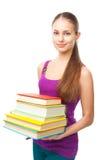 Pile de sourire de participation de fille d'étudiant de livres Photos stock