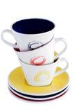 Pile de trois tasses colorées Photographie stock