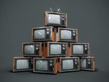 Pile de vieilles rétros TV sur le fond foncé Image stock