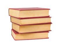 Pile de vieux livres avec les caches rouges Image libre de droits
