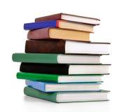 Pile de vieux livres d'isolement sur le blanc Photo stock