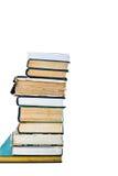 Pile de vieux livres d'isolement sur le blanc Photos stock