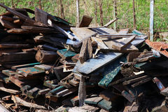 A pile of debris and old broken wooden boards after demolition o Royalty Free Stock Photos