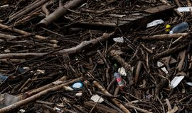 Pile of debris and waste after flood. Waste problem in the environment. Problem of plastic from households. Waste management. Behavior concept. Household solid royalty free stock image