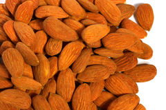 A pile of delicious natural almonds. A bunch of sweet delicious healthy almonds Royalty Free Stock Image