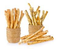 Pile of delicious pretzel sticks on white background Stock Images