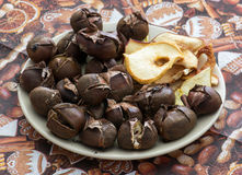 Pile of a delicious roasted chestnuts and dried sliced apples Stock Photo