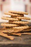 Pile of delicious vanilla cookies surrounded by. Cinnamon sticks on wooden table Royalty Free Stock Image