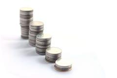 Pile della moneta su un fondo bianco Fotografie Stock