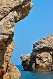 Pile della roccia nel mare Fotografie Stock Libere da Diritti